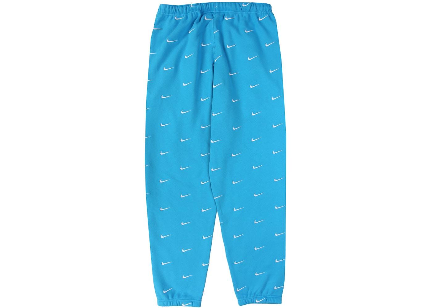 Milagroso efectivo frente  Nike All Over Swoosh Logo Pants Blue - FW19